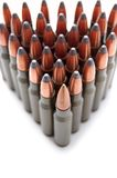 Game hunting cartridges. Arranged in a triangular array on a white background Stock Photos