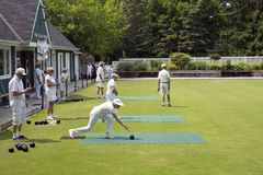 Game of Lawn Bowls - Oakville Lawn Bowling Club. Players dressed in white are a familiar sight at the historic Oakville Lawn Bowling Club established in 1908 and Royalty Free Stock Photography