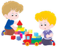 Game. Little boys playing with a toy truck and bricks royalty free illustration