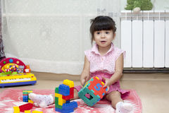 Game. Little girl playing with toys Royalty Free Stock Image