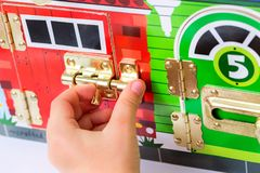 A game with locks. The child opens the locks. Busy-board for For children. Children`s educational toys Royalty Free Stock Photography