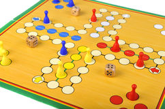 Game of Ludo. The ancient board game of Ludo (Take it Easy) is trully international. It has its original and specific name and version in many countries across Stock Images