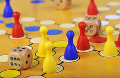 Game of Ludo. The ancient board game of Ludo (Take it Easy) is trully international. It has its original and specific name and version in many countries across Royalty Free Stock Photography