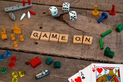 `Game On` made from Scrabble game letters. Risk, Battleship pieces, Monopoly, Settler of Catan and other game pieces stock images