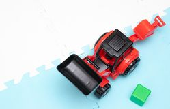On the game mat tractor. Toys for young children. educational toys. Early development stock images