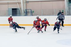 Game moment of children ice-hockey teams Royalty Free Stock Photos