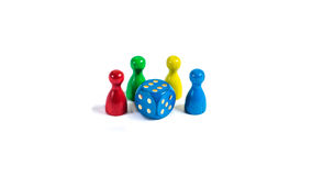 Game night. Board game figures in front of white background Stock Photo