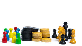 Game night. Board game pieces in front of white background Royalty Free Stock Photo