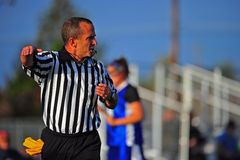 Game official making a call. As he moves down the field with the action Royalty Free Stock Image
