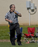 Game official ready for the call. Game official reaedy for a call as he watches the action moves down the field Royalty Free Stock Photos