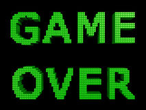 Game over green text. Game over text made of green glossy cubes isolated on black background. 3d illustration Royalty Free Stock Images