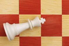 Game over - king down, chess metaphor Royalty Free Stock Photo