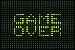 Game Over LED Matrix. Arcade Game Over message displayed in green LEDs on a black background royalty free illustration