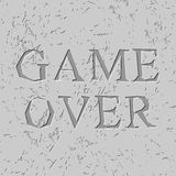 Game over letters carved on stone plate. Chips on rock Royalty Free Stock Image