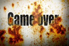 Game over on rusty piece of metal. As background Stock Images