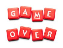 Game Over Plastic Tiles. Game Over Spelled with Wood Tiles Isolated on a White Background royalty free stock photography