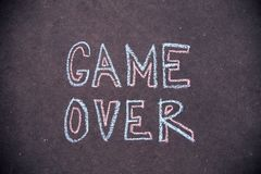 Game over text on concrete background Royalty Free Stock Images