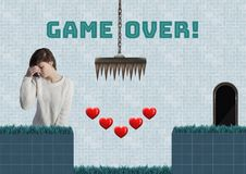 Game over text and woman in Computer Game Level with hearts and traps. Digital composite of Game over text and woman in Computer Game Level with hearts and traps royalty free illustration