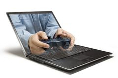 Game Pad. A Hand reaching out of a computer Royalty Free Stock Photos