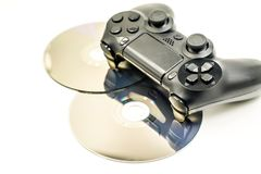 Game Pad and a CD isolated on a white background. Black game controller and cds isolated on white Stock Images