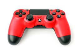 Game Pad for Console SONY PlayStation 4. Red joystick DualShock 4 for Sony PlayStation 4 game console of the eighth generation. The official announcement took Royalty Free Stock Photos