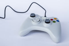 Game pad controller. Game controller isolated on a white background royalty free stock photography