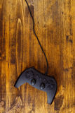 Game pad controller on wooden desk, flat lay top view Stock Images