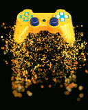 Game pad - pixel explosion. Isolated on black background stock photos