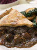 Game Pie with Fried Curly Kale and Potatoes Royalty Free Stock Image