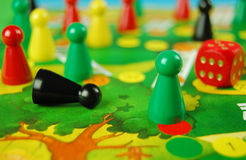 Game pieces on board Stock Photos