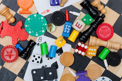 Game pieces on a chess board Stock Photography