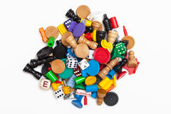 Game pieces. A pile of miscellaneous game pieces royalty free stock photos