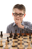 Game Plan. A young chess player contemplates a game plan or strategic move Royalty Free Stock Image