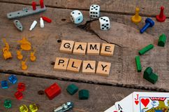 `Game Play` made from Scrabble game letters. Risk, Battleship pieces, Monopoly, Settler of Catan and other game pieces stock photo