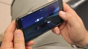 Game playing on mobile phone stock video