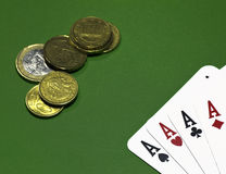 The game of poker. Poker of aces and money on green table Royalty Free Stock Photos