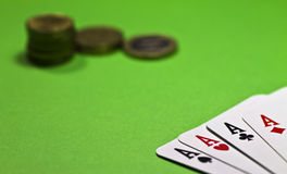 The game of poker. Poker of aces and money on green table Royalty Free Stock Image