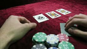 Game of poker. the combination of a pair of aces. a chance to win. man makes a bet. lie around the chips. the game is on stock video