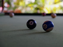 A game of pool. Pool balls in a open pub Royalty Free Stock Photos