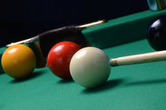 Game of pool. Closeup of game of pool in action with red ball about to be hit in middle pocket Stock Images