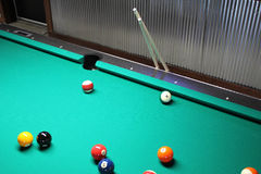 A Game of Pool In Progress with Cues Stock Image