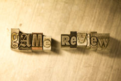 Game review - Metal letterpress lettering sign close-up Stock Images
