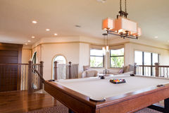 Game room in upscale luxury home Stock Photography
