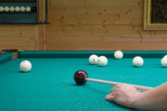 Game of Russian Billiards, kick the ball cue on the green table royalty free stock photos