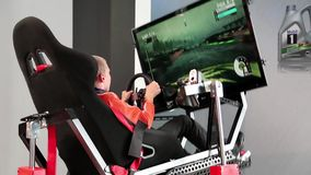 Game simulator. KIEV, UKRAINE, AUGUST 24, 2012: Boy inside game simulator in Kiev, Ukraine, August 24, 2012 stock video