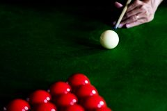 Game snooker billiards or opening frame player ready for the ball shot, athlete man kick cue on the green table in bar royalty free stock photos