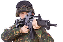 Game at the soldiers. One soldier with the gun in the hands on a white background Royalty Free Stock Photo