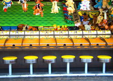 Game Stools. View of carnival game horserace waiting for players Stock Photography