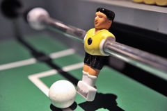 Tabletop football player with ball Stock Photo