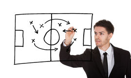Game strategy on blackboard. Man writing football game strategy on white screen Stock Photos